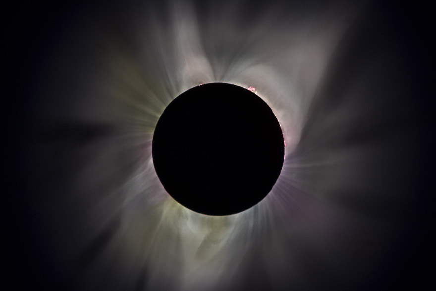 Corona of the sun at totality, six-photo composite.